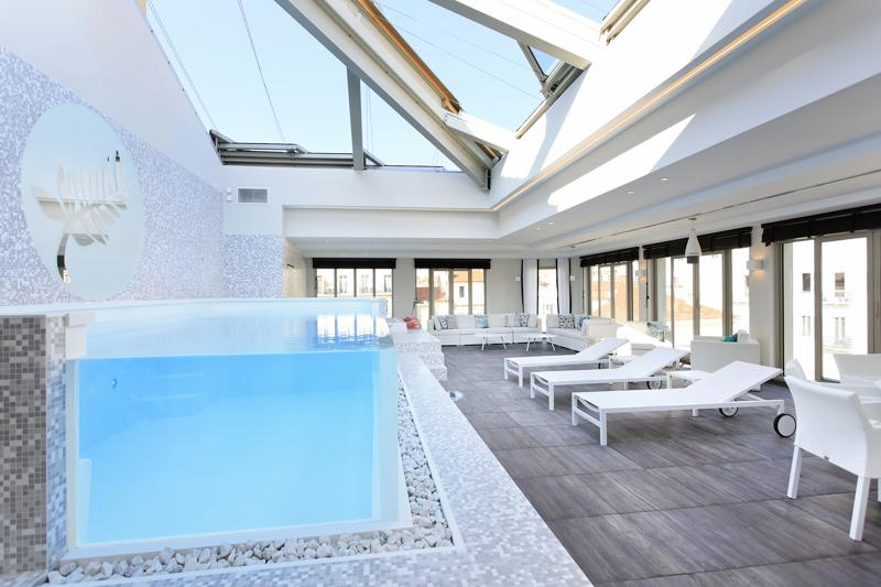 Glass covered rooftop with a swimming pool and views in a Cannes party accommodation near to Palais des Festivals