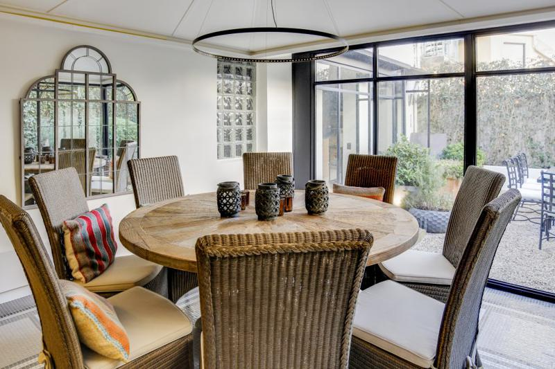 Round table with 8 chairs overlooking outdoor patio in Cannes