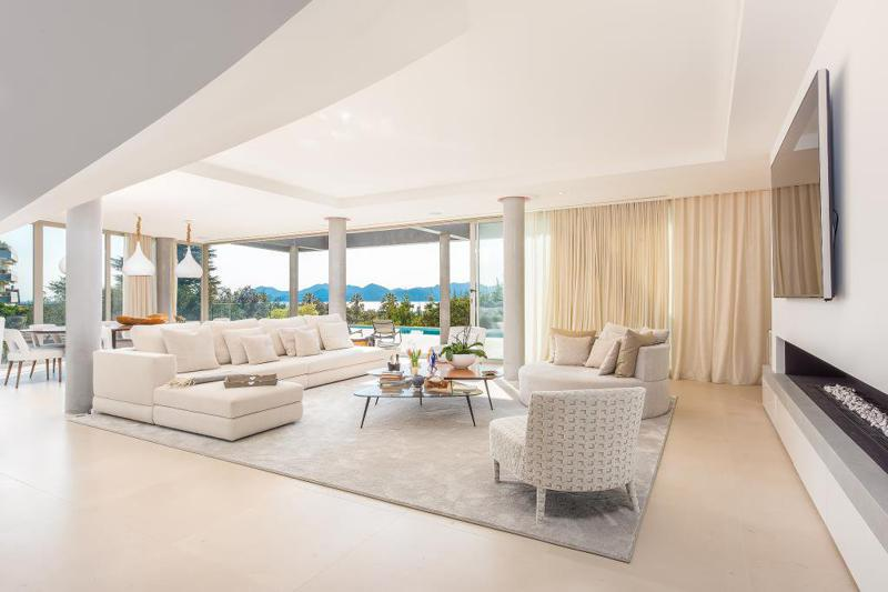 Spacious living room with office space, modern interiors and sea view in a Cannes private villa for rental with gym